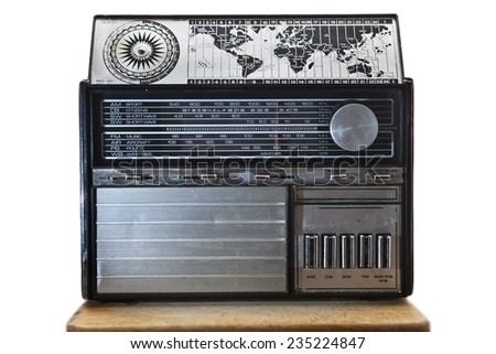 Old international dial radio isolated over white background, placed on wooden surface