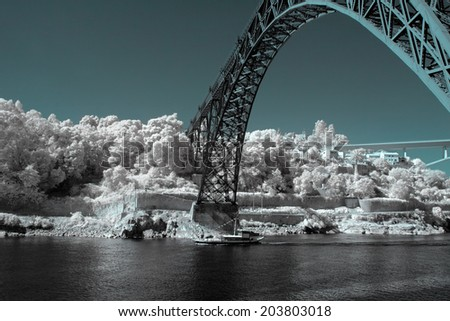 Old iron bridge D. Luis over Douro river, Porto, Portugal. Used infrared filter. - stock photo