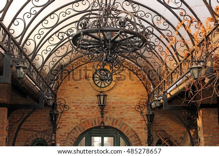 old iron chandelier and lanterns