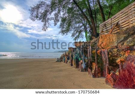 old iron cliff on the seashore - stock photo