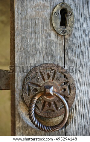Old iron door furniture on oak doors