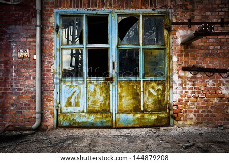 Old iron door glass brick wall - stock photo