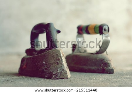 Old iron for ironing clothes - stock photo