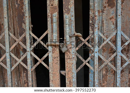 Old  iron gate padlock with old chain  - stock photo