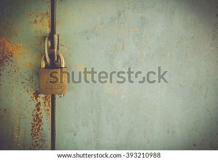 Old iron lock on the locker. - stock photo