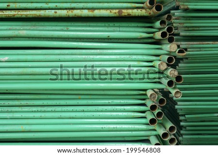 Old iron pipes stacked background - stock photo