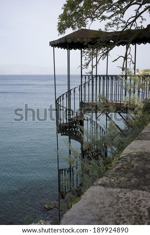 Old Iron Stairway in Old Fortress in City of Corfu Town on Corfu Island Greece on a sunny summer day - stock photo