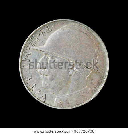 Old Italy money. Silver coin 20 Lire 1928. Isolated black background.  - stock photo