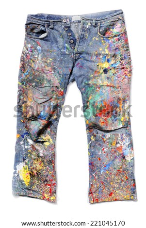 Old Jeans covered with acrylic artist's paints. - stock photo