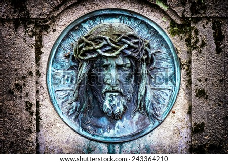 old jesus christ relief at a historic gravestone - stock photo