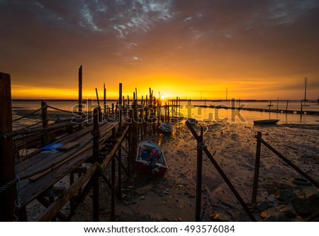 Old jetty for fisherman, cloudy Sunset in Teluk Sengat Kota Tinggi, Johor, Southern Malaysia. The image may have soft, blurry and noise due to long exposure