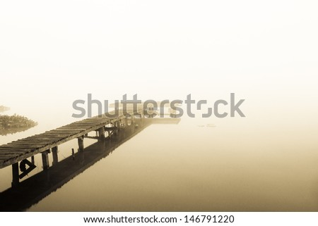 old jetty walkway pier at the lake in morning
