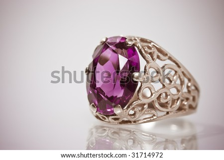 Old jewelry golden ring with stone. Object on vignette background