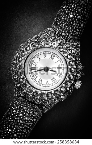 old jewelry woman watch on textured background - stock photo