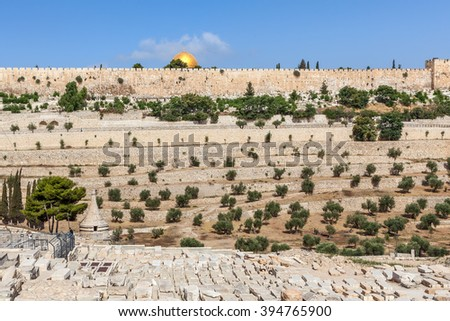 Old jewish cemetery and ancient walls on background in Jerusalem, Israel.