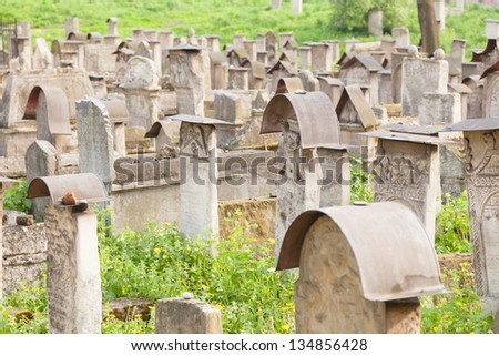 Old Jewish cemetery is located beside the Remuh Synagogue at 40 Szeroka Street in the historic Kazimierz district of KrakÃ?Â?w. - stock photo