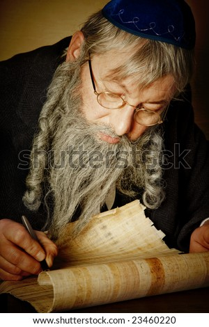 Old jewish man with beard writing on a parchment scroll - stock photo