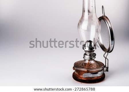 old kerosene lamp with mirror isolated on white background - retro - stock photo