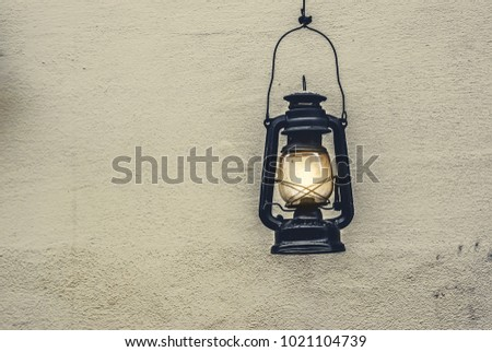 Old Kerosene Lamps Hang On The Wall In The City