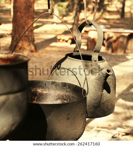 Old kettle in camping - stock photo