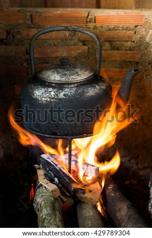 old kettle on charcoal grills - stock photo