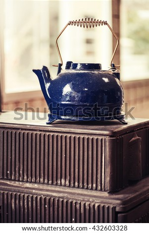 old kettle on charcoal grills, Kettle on the stove, Still life style - stock photo