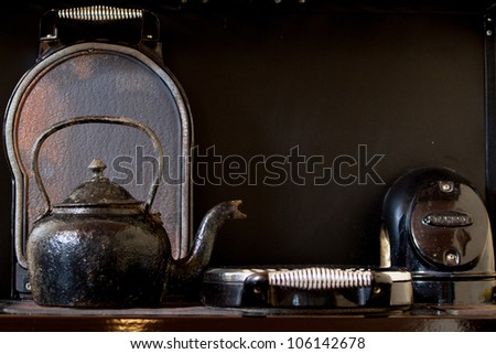 Old kettle on the stove - stock photo