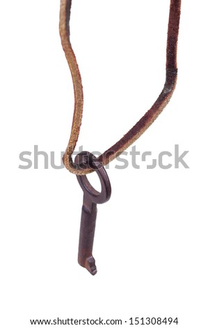 Old key hanging on a leather rope. Close-up. Isolated on white background.