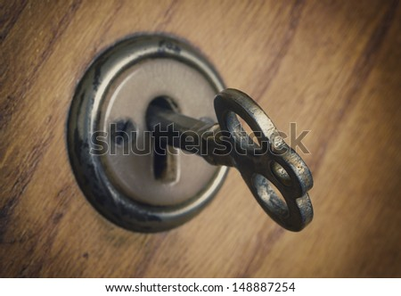 old key in the cabinet door - stock photo