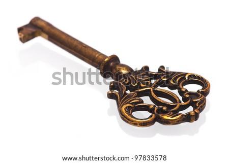 Old key isolated on white - stock photo