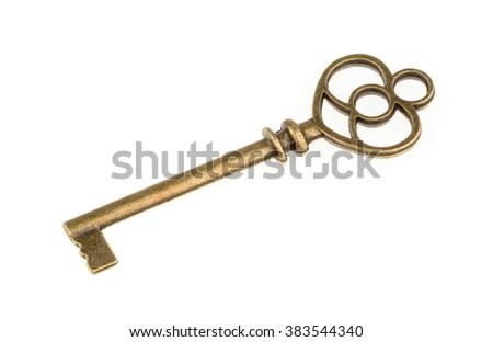 Old key isolated on white background - stock photo