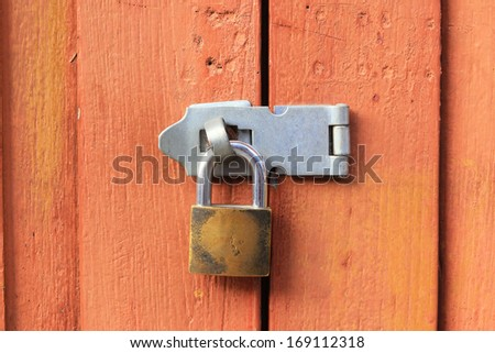 Old Key Lock on Wood Door