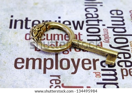 Old key on employer text - stock photo