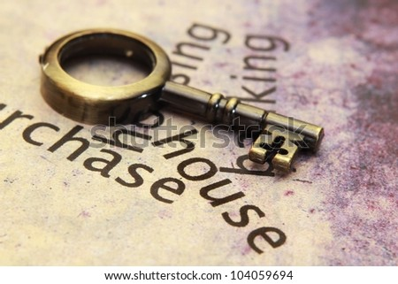 Old key on house text - stock photo