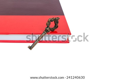 old key on red book isolated - stock photo