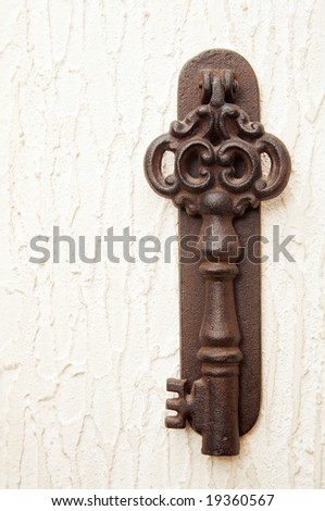 Old key on the wall - stock photo