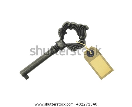 Old key with a tag isolated on white background.