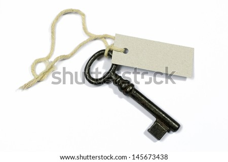 old key with blank label on white background