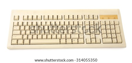Old keyboard isolated on white - stock photo
