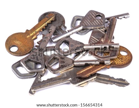 Old keys lying disorderly on white. Close-up. Isolated on white background. - stock photo