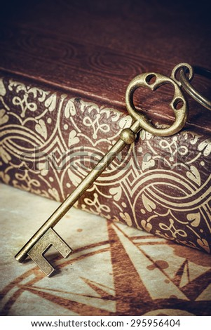 old keys on a old book, antique texture background - stock photo