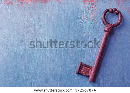 Old keys on blue wooden background, copy space - stock photo