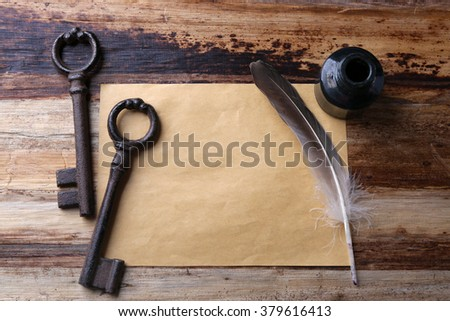 Old keys with papers, ink and pen on  wooden background, close up