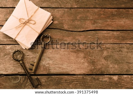 Old keys with papers, ink and pen on wooden background, close up - stock photo