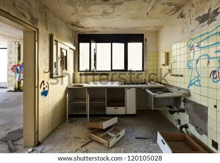 old kitchen destroyed, interior abandoned house - stock photo