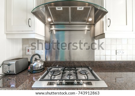 Old Kitchen Stove And An Exhaust Hood