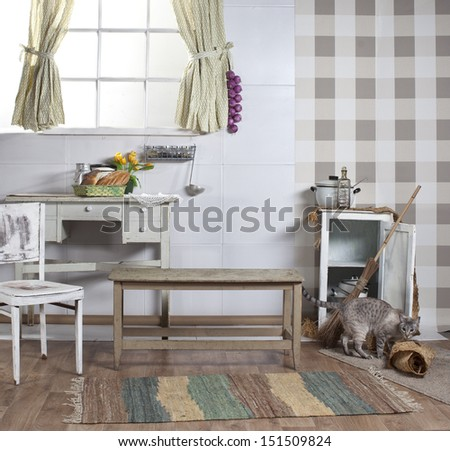 old kitchen with window, cats and light furniture - stock photo