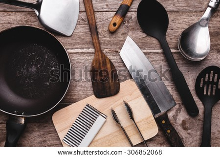 Old kitchenware on wooden background. - stock photo