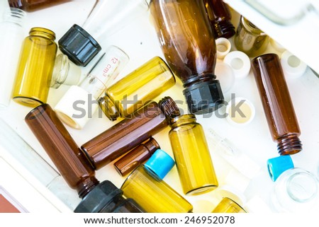 old laboratory with a lot of bottles and dirt - stock photo
