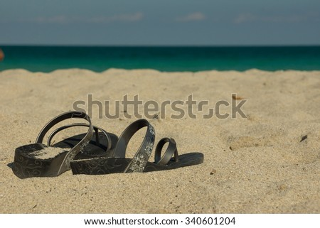 Old ladies shoes lying on the beach